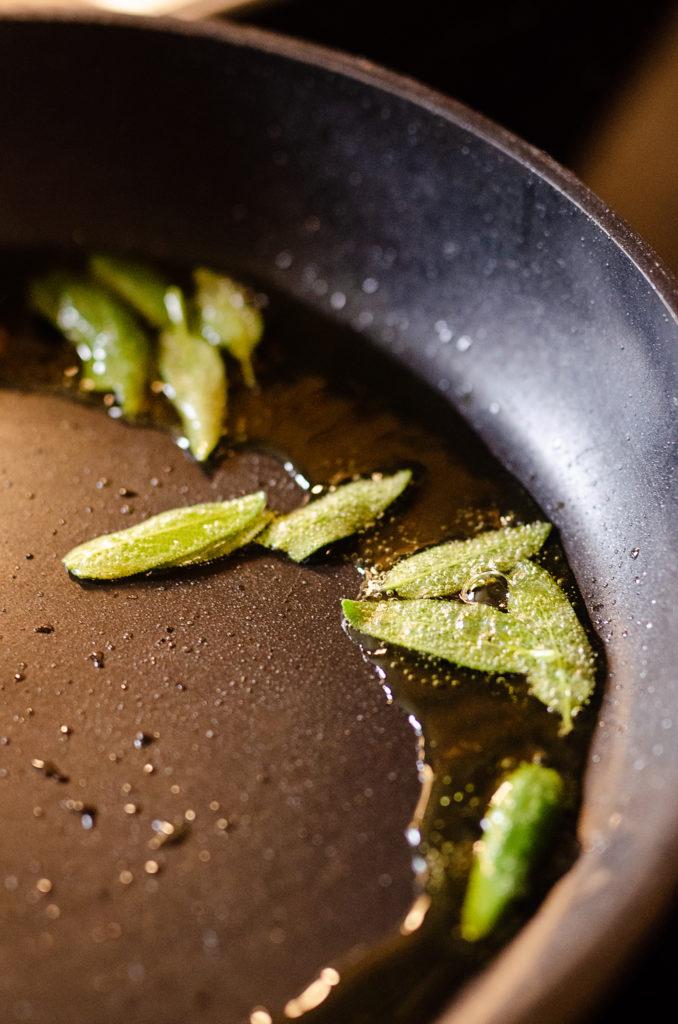 sage leaves fried in oil in pan