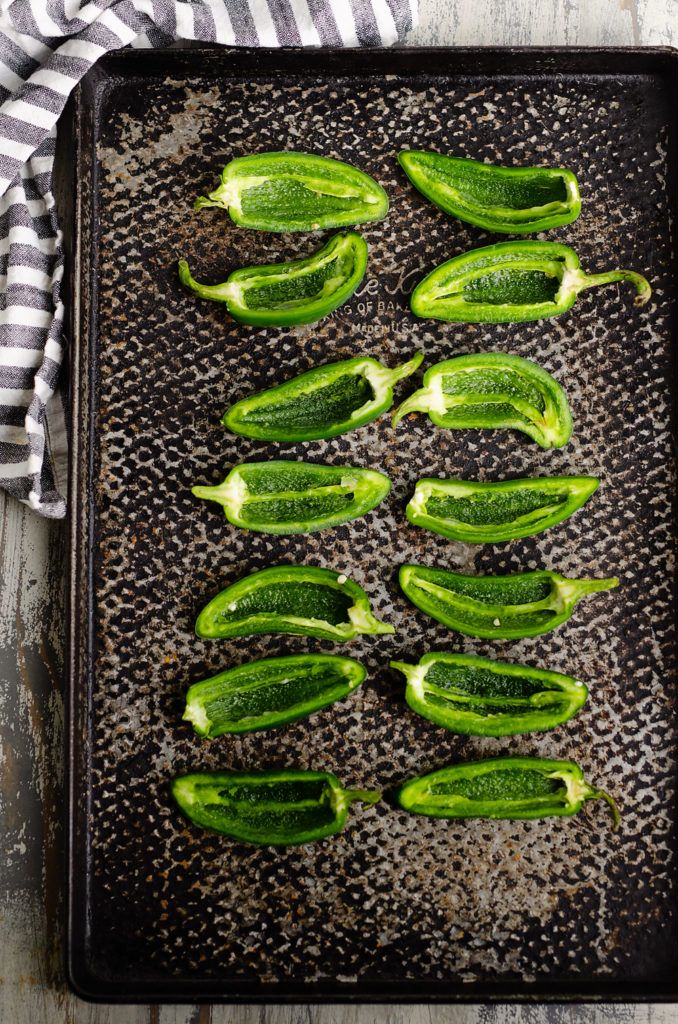 Jalapenos halved and seeded on sheet pan