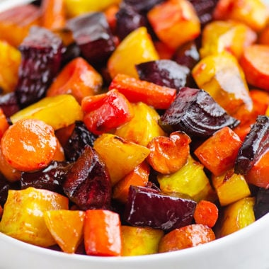 Honey Roasted Beets & Carrots in white bowl on table
