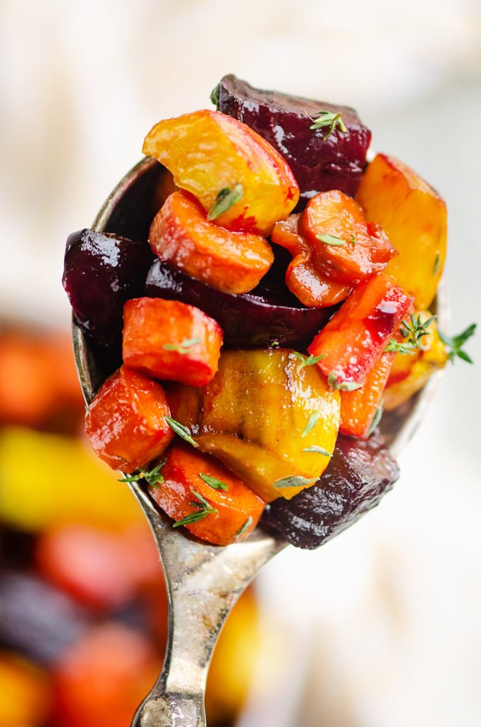 Honey Roasted Beets & Carrots in spoon with fresh thyme