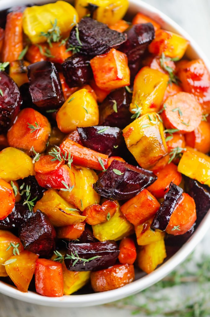 Honey Roasted Beets & Carrots in white bowl topped with fresh thyme