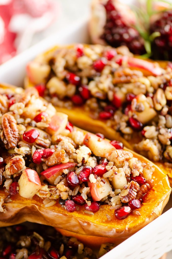 Stuffed Butternut Squash with Apples, Pomegranates & Grains in baking pan
