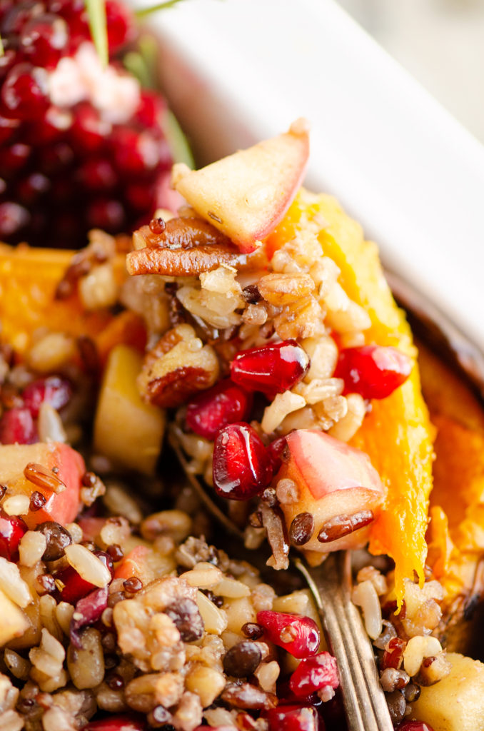 Stuffed Butternut Squash with Apples, Pomegranates & Grains spoonful being scooped out