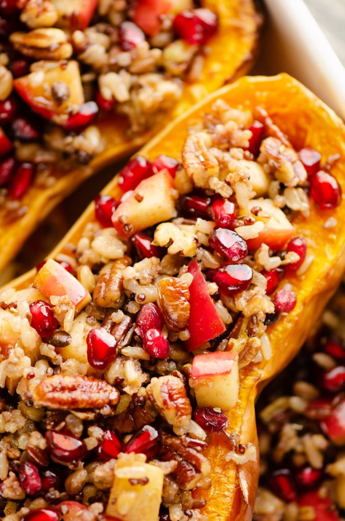 Stuffed Butternut Squash with Apples, Pomegranates & Grains in baking dish