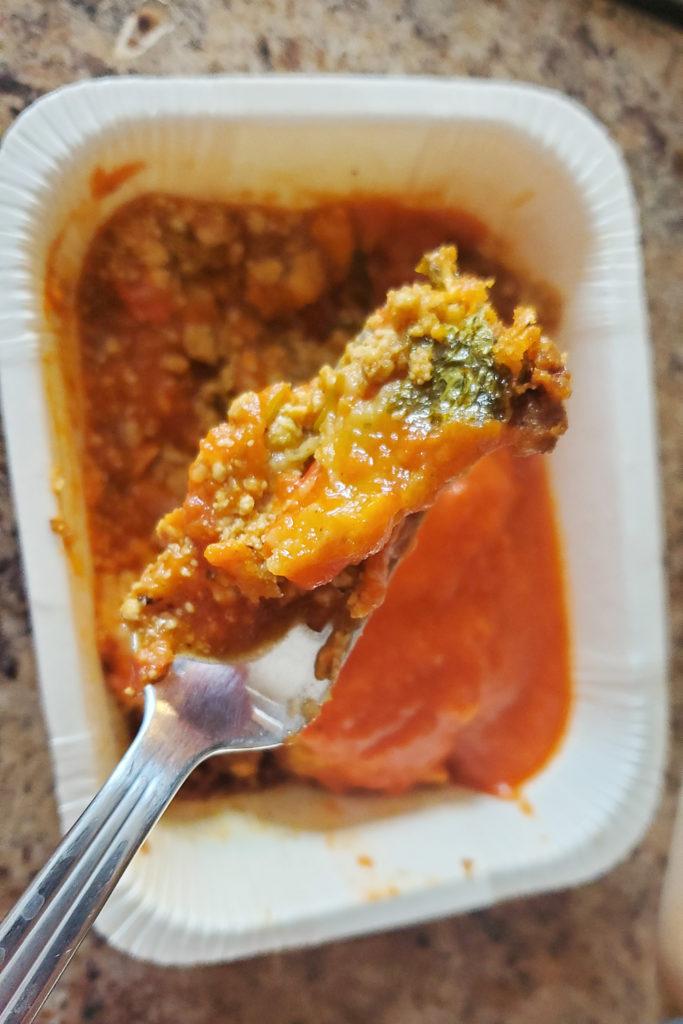 Veestro Enchilada Casserole bite on fork