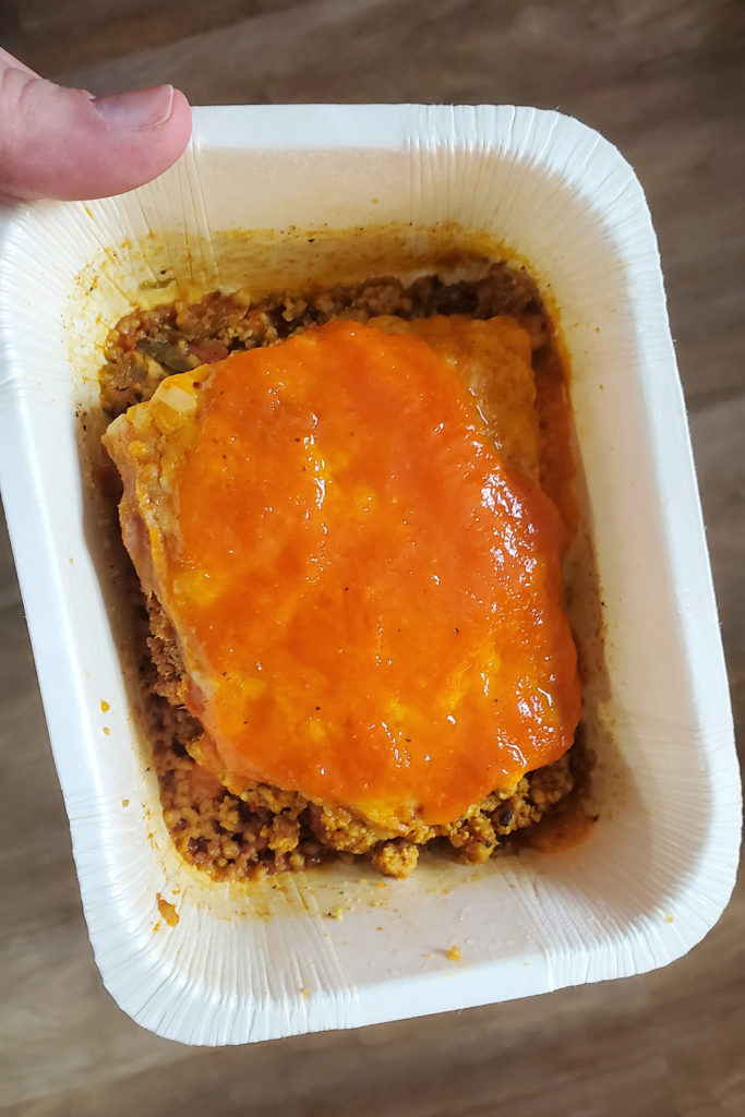Veestro Enchilada Casserole vegan meal in white paper container
