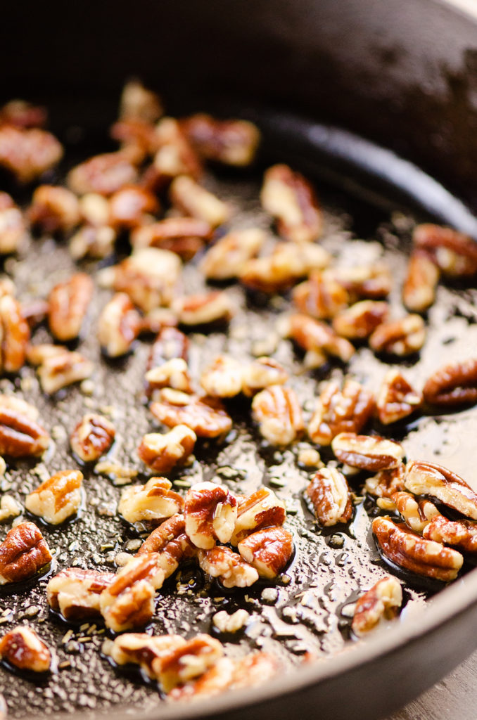 toasted pecans with olive oil in skillet
