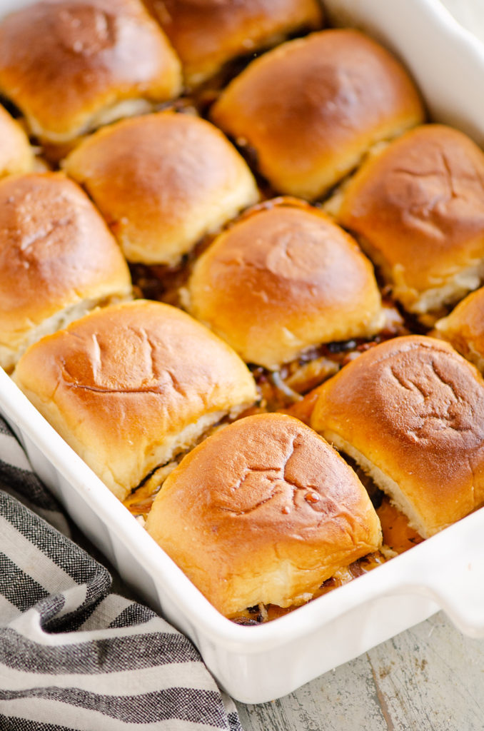 Cheesy Turkey Baked Sliders in white pan