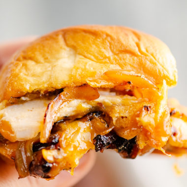 holding Cheesy Turkey Slider in hand