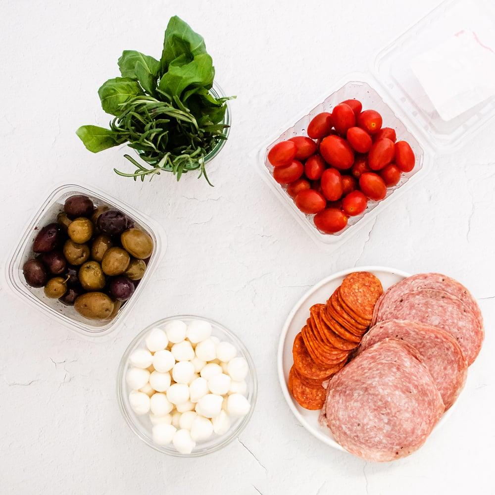 antipasto ingredients on white table