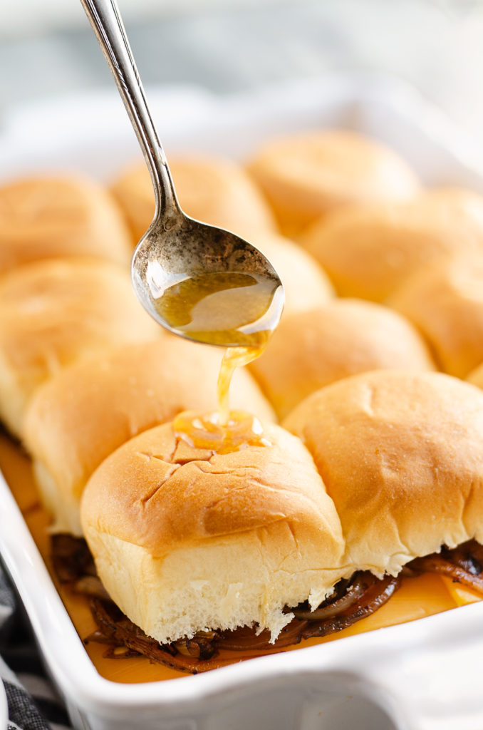 savory butter sauce poured on Hawaiian roll turkey sliders