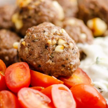 Greek meatball bowls with tomatoes and yogurt sauce