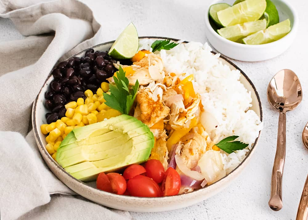 pressure cooker chicken fajita bowls on table with napkin and spoons