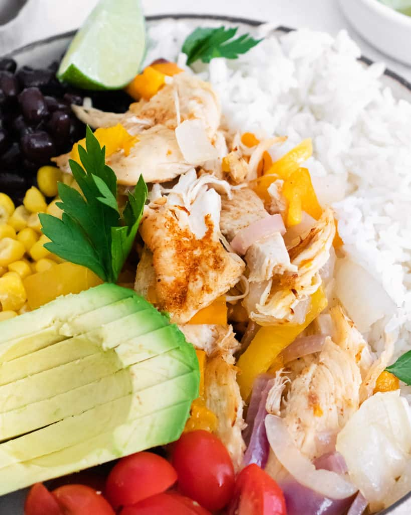 pressure cooker chicken fajita bowls made with avocado, rice, corn and black beans