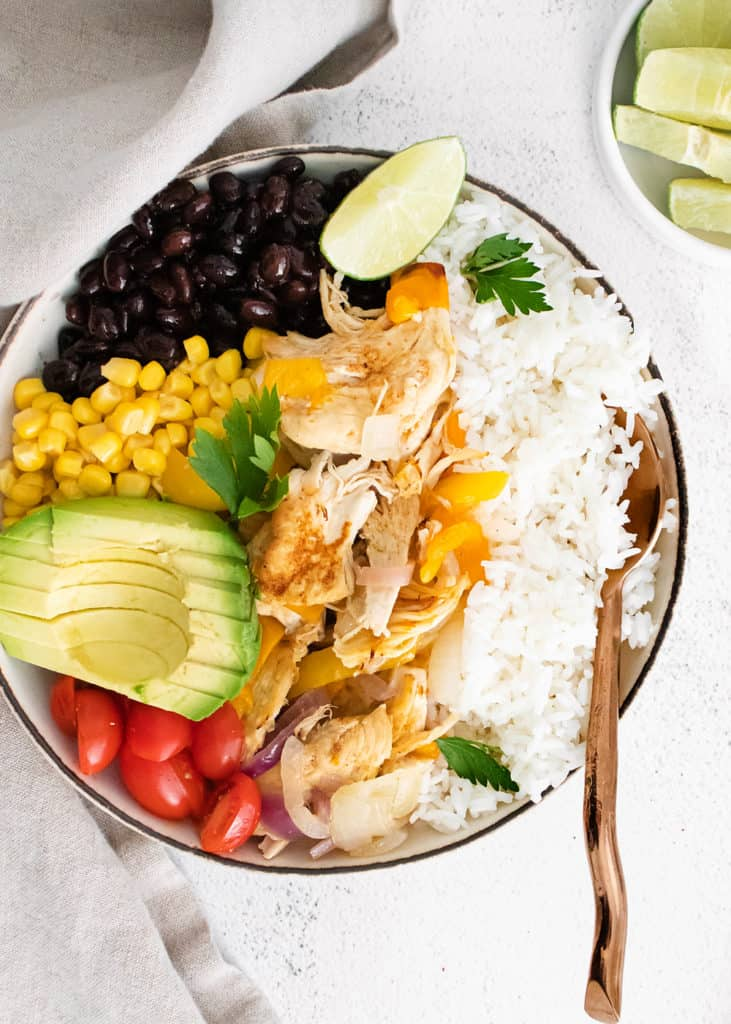 Instant pot chicken fajitas in bowl with spoon