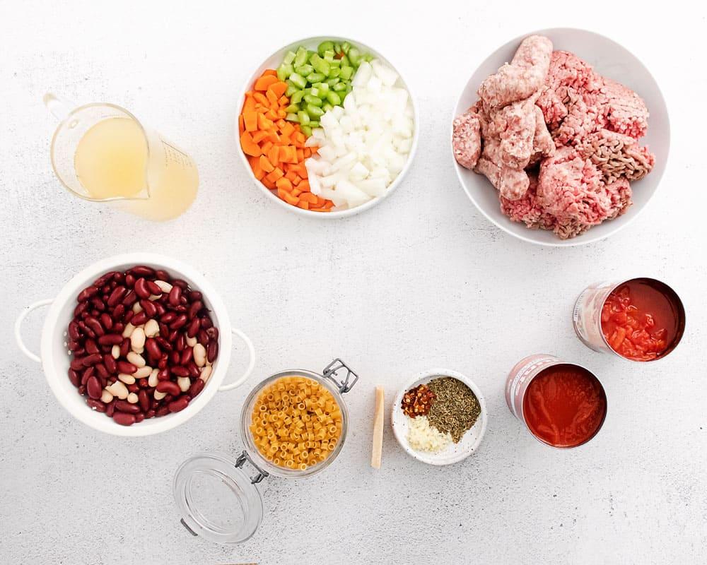 pasta e fagioli soup ingredients on white table