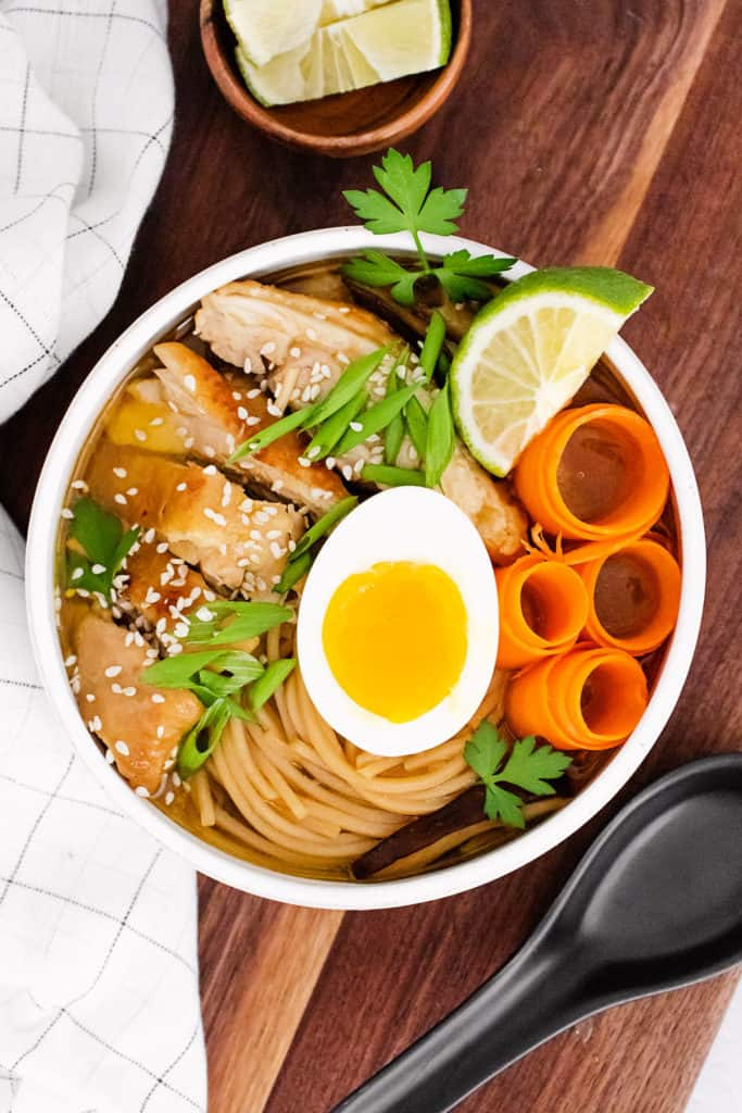Chicken Ramen with Sweet Chili Oil served in bowl with lime wedge