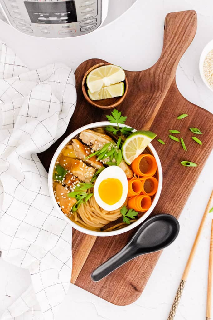 Chicken Ramen with Sweet Chili Oil in bowl on cutting board