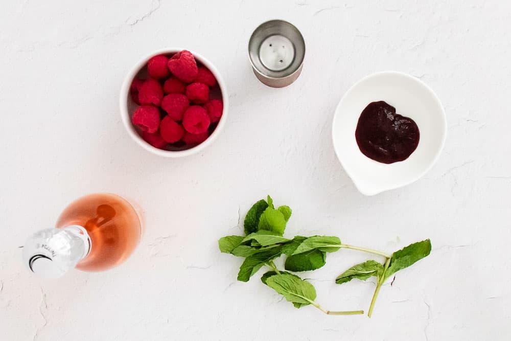 Raspberry Rosé Spritzer on white table