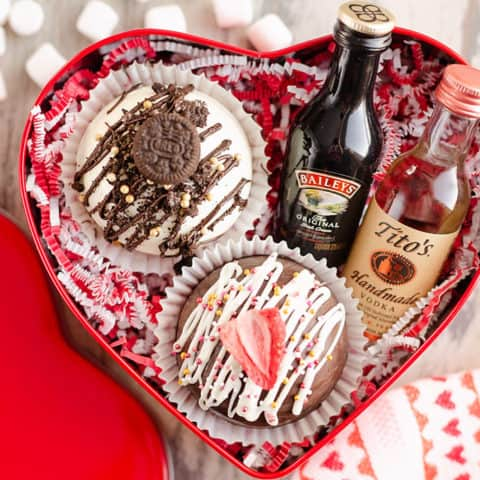 red tin heart gift box with mug, hot cocoa bombs and alcohol