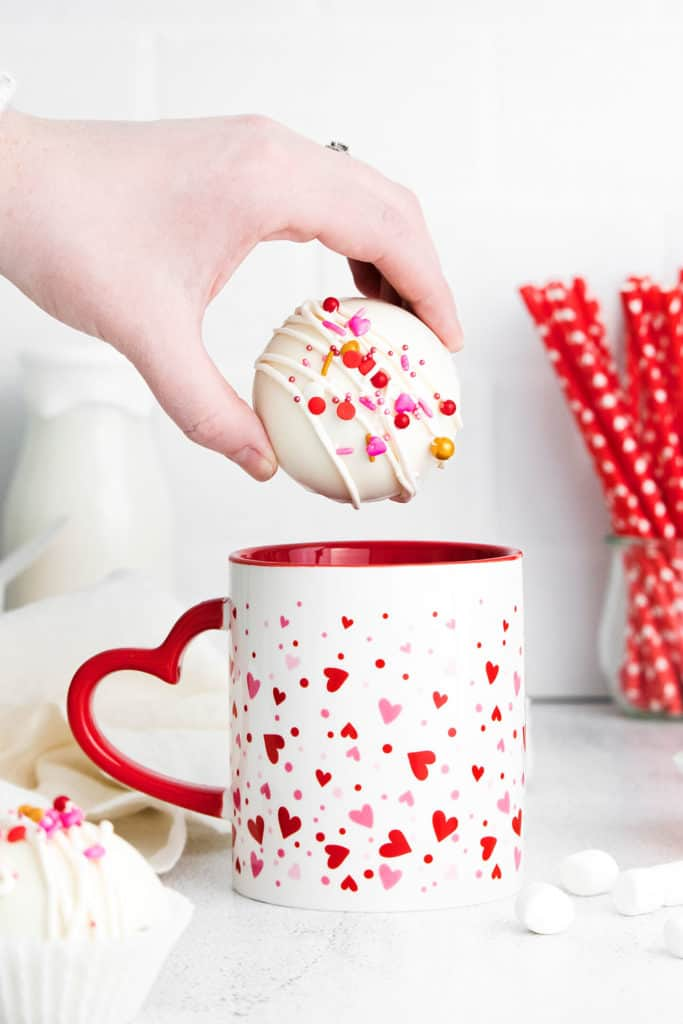 Valentine Hot cocoa bomb being added to a mug
