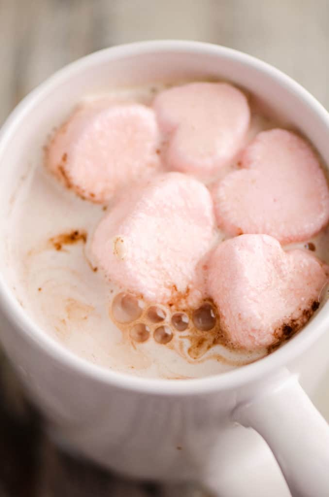 Valentines Hot Chocolate with pink heart marshmallows in a white mug
