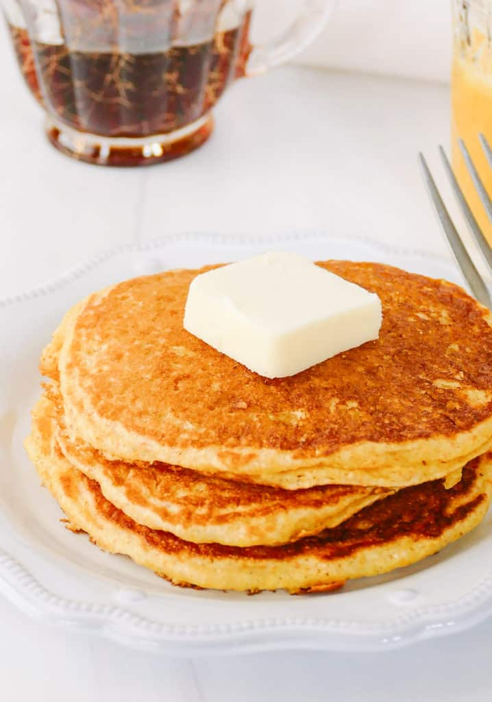 cornmeal pancakes topped with butter
