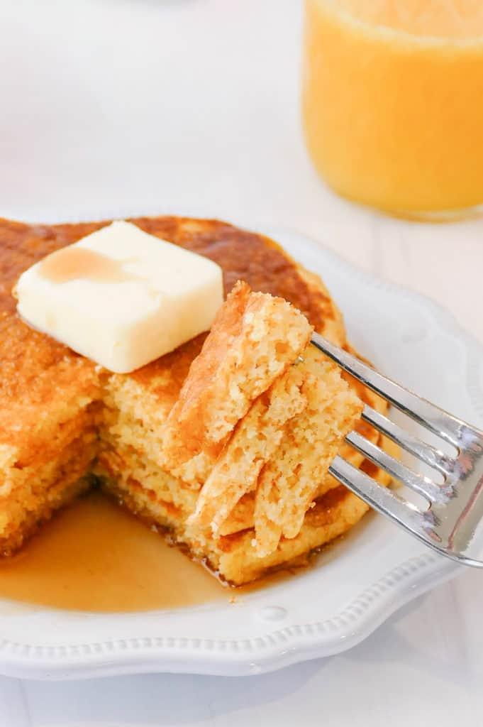 bite of cornmeal pancakes on fork