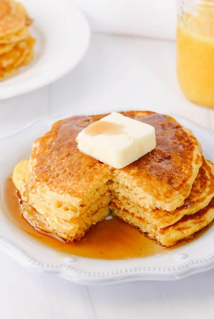 cornmeal pancakes with bite taken out