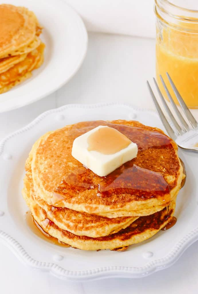 cornmeal pancakes topped with butter and syrup