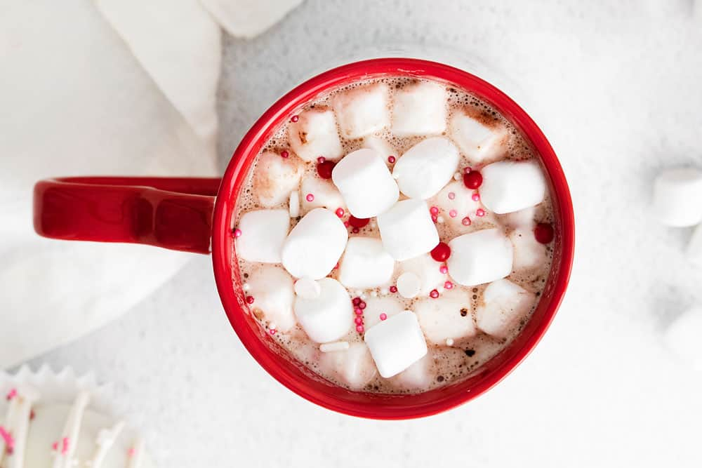 red mug with hot cocoa and marshmallows
