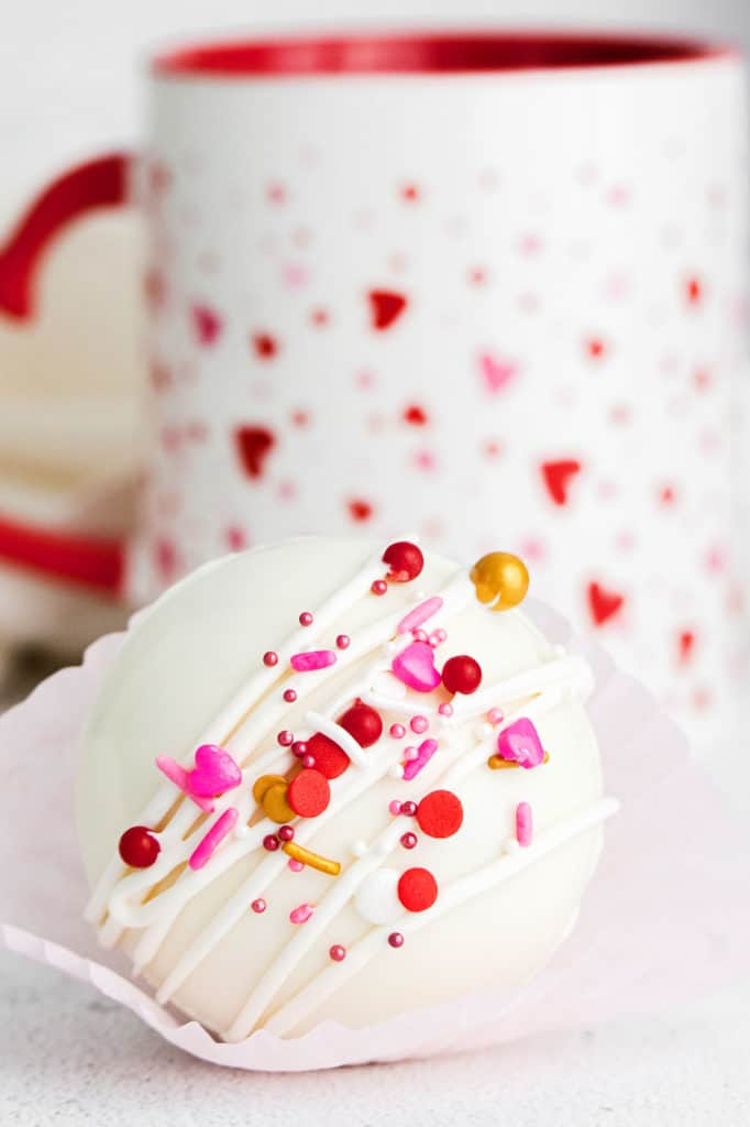 white chocolate hot cocoa bomb with heart sprinkles