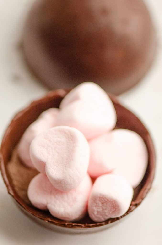 hot cocoa bomb with pink marshmallows inside