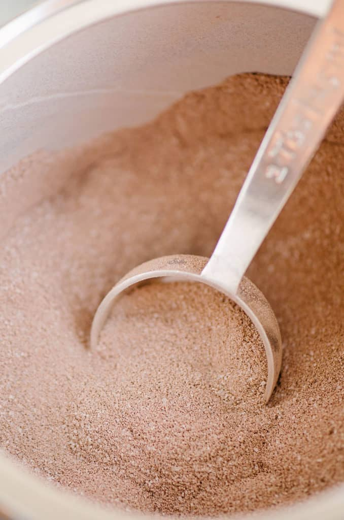 hot cocoa mix in container with tablespoon