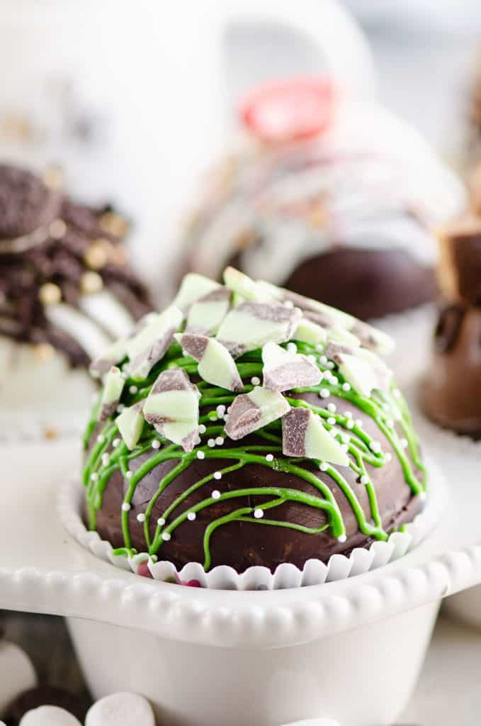 mint hot cocoa bomb in muffin tin