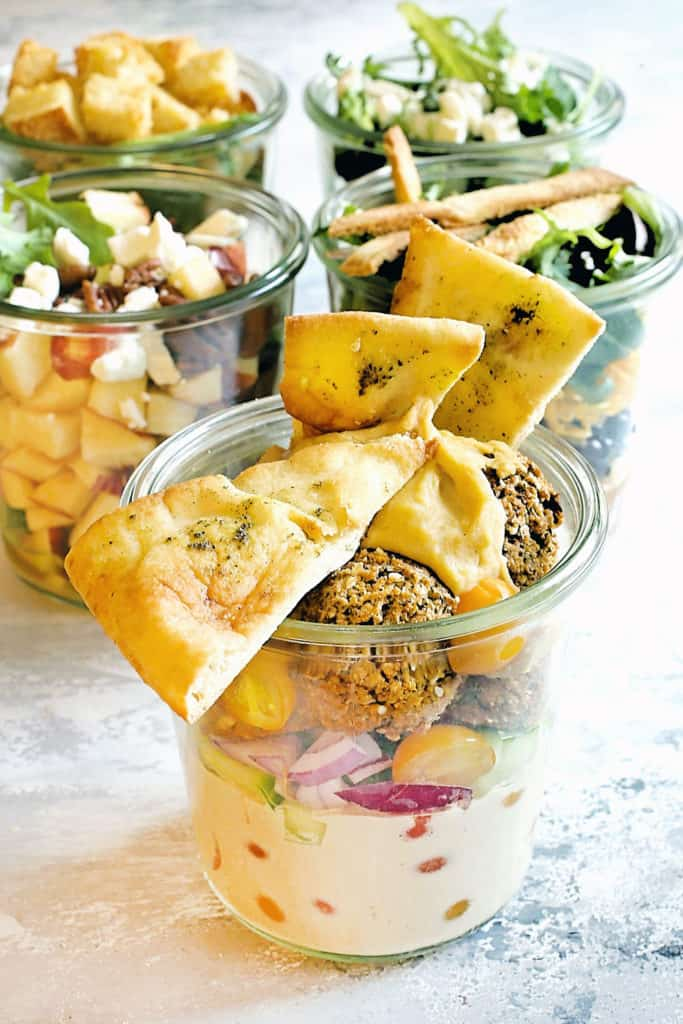 falafel salad in a jar with toasted pita chips