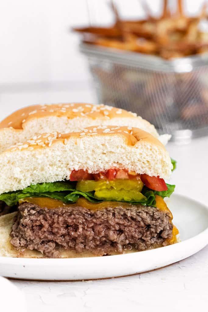cheeseburger cut in half on plate