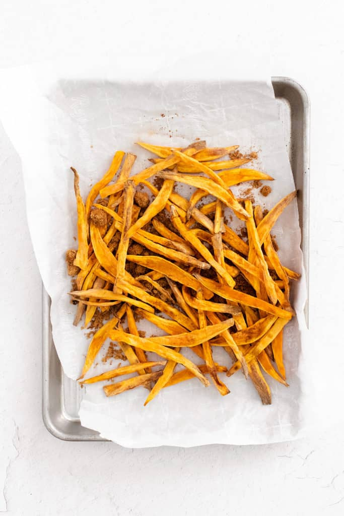 sweet potato fries on sheet pan with parchment