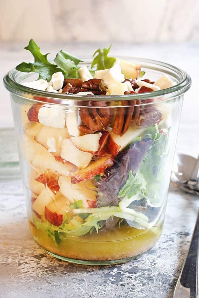 apple and candied pecans in jar