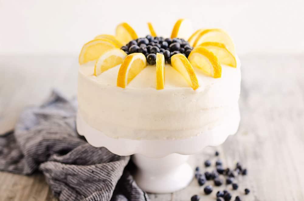 buttercream cake topped wtih fresh blueberries and lemon slices