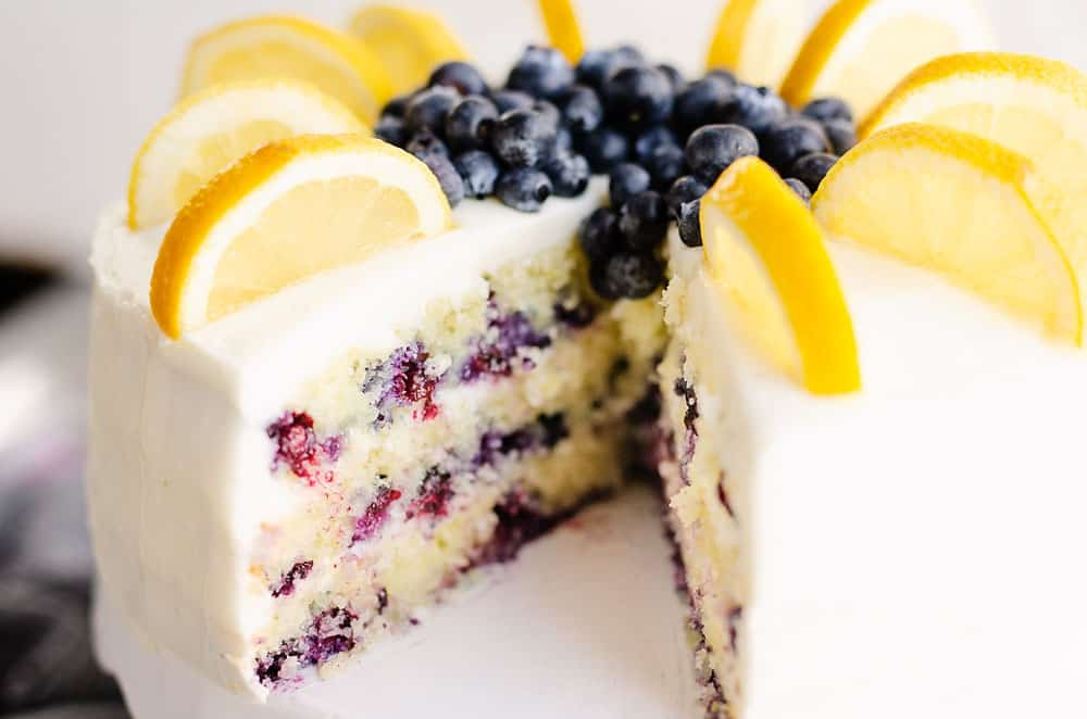 buttercream cake with blueberry layers with slice removed