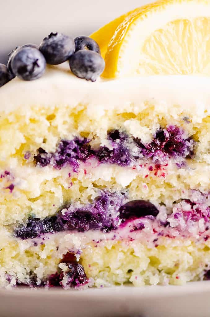 layeres of blueberry cake with buttercream