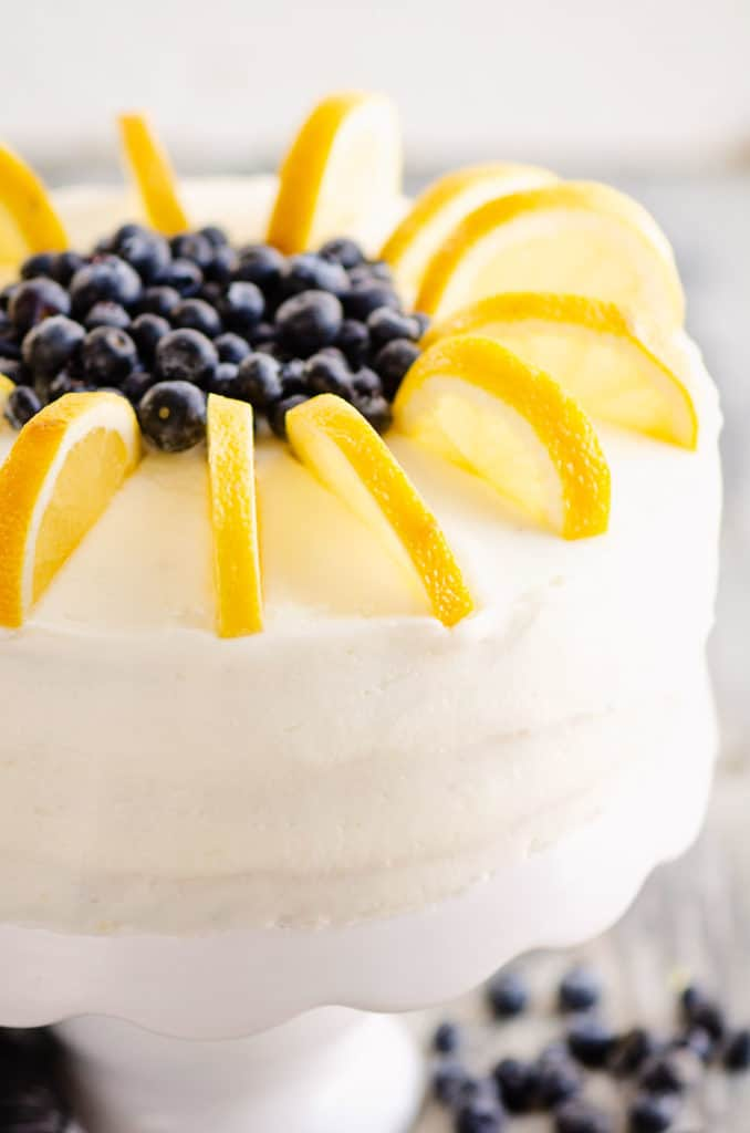 buttercream cake topped with fresh blueberries and lemon slices