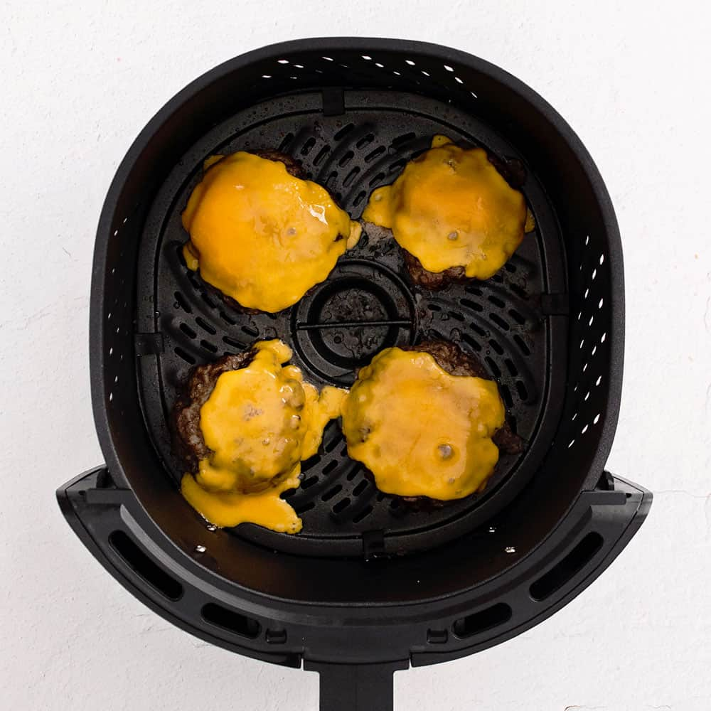 cheeseburgers in air fryer with melted cheese