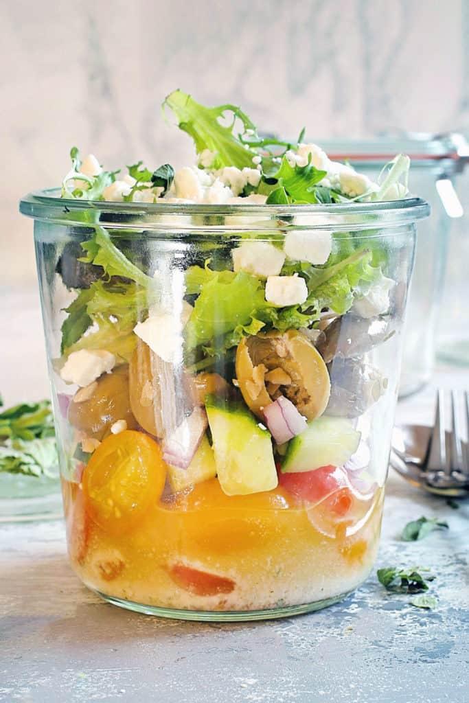 greek veggie salad in a glass jar