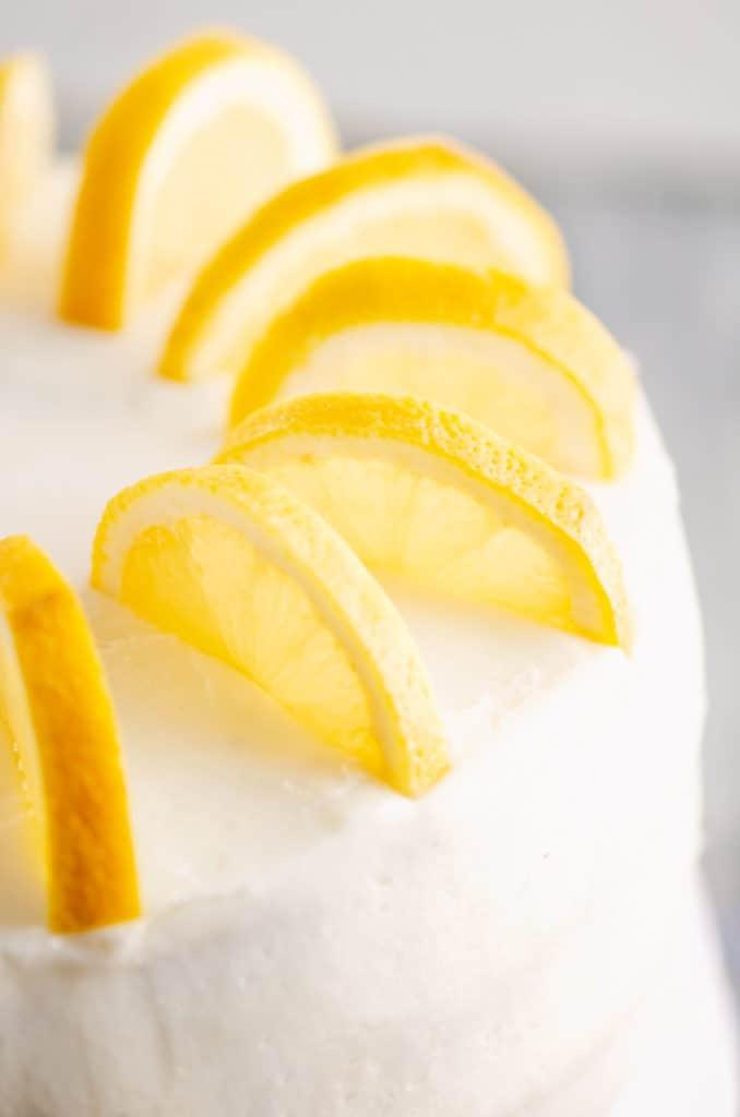 fresh slices of lemon on buttercream cake