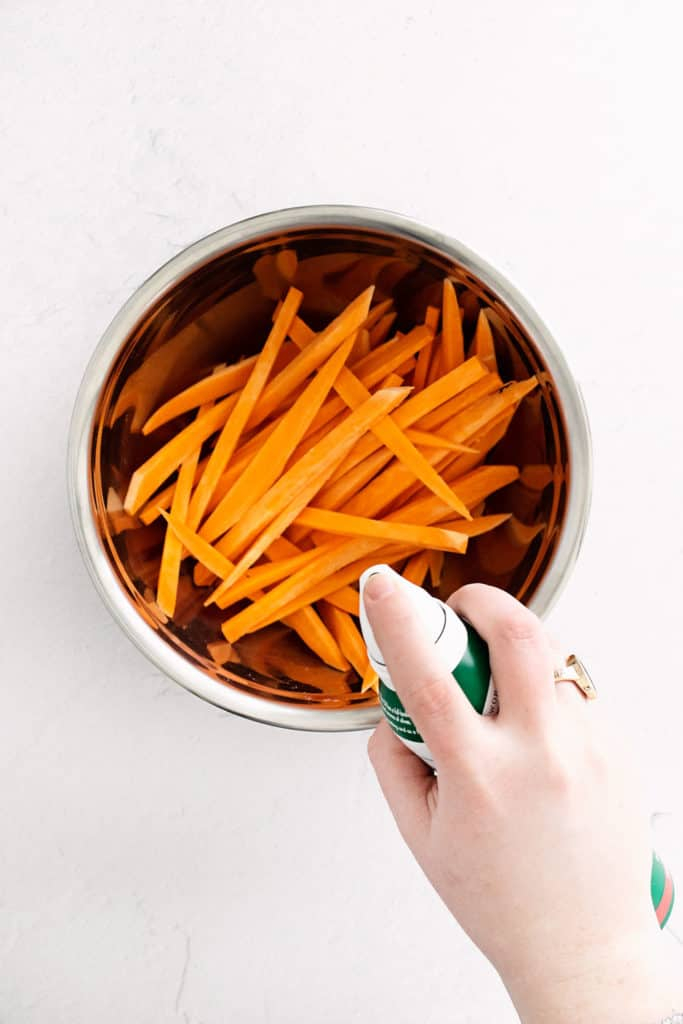 sweet potato fries in bowl with oil