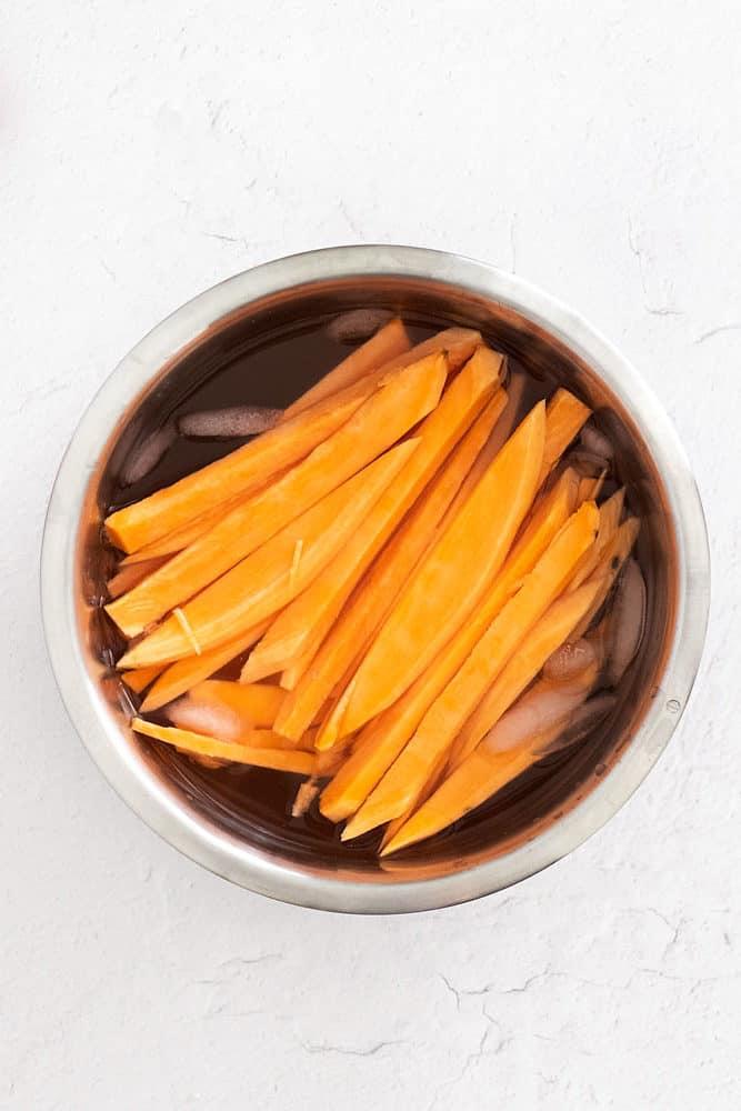sweet potato fries in ice bath