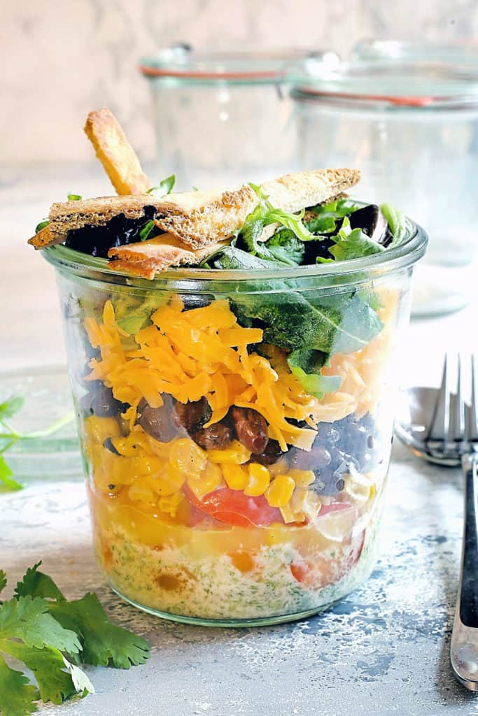 tex mex salad in a jar with corn and black beans