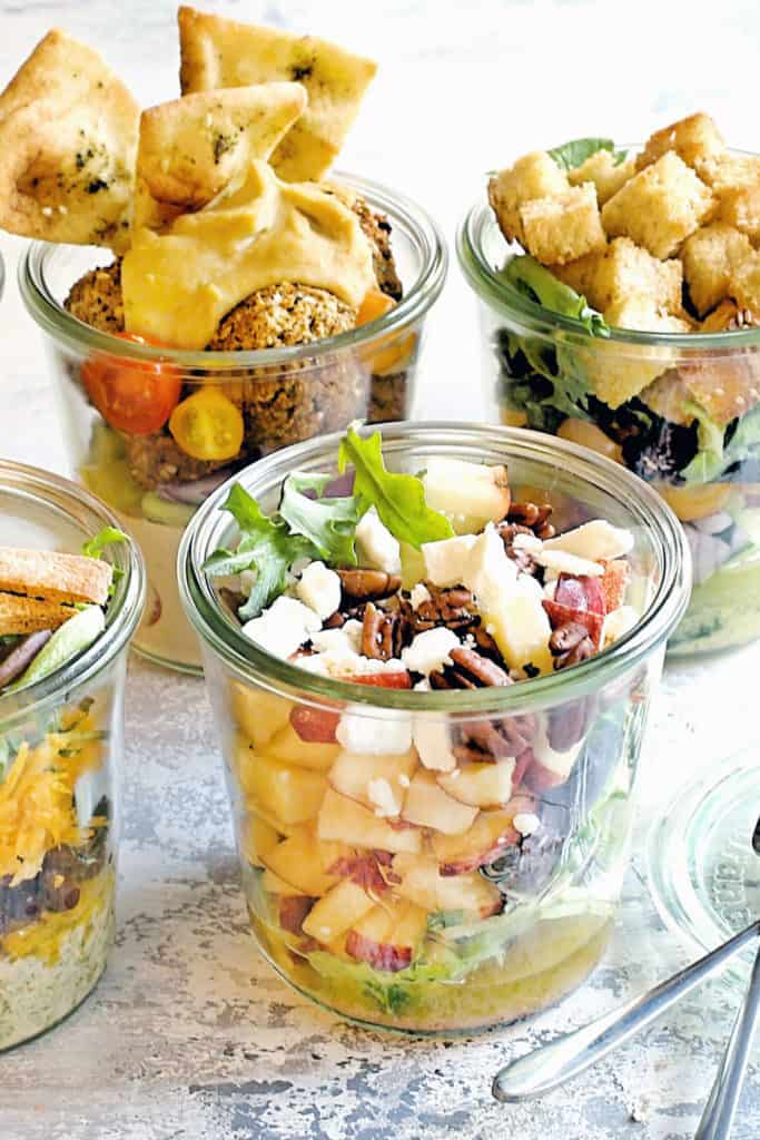 vegetable salads in a jar on table